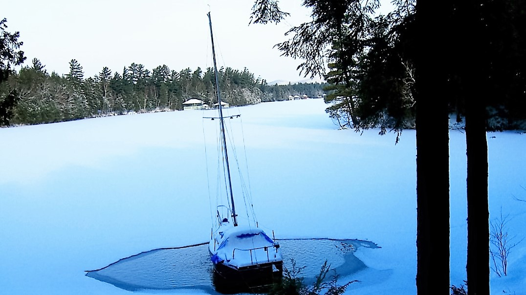 Boat in ice by Michael Franklin